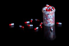 Container full of pills Stock Photo