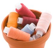 Container full of spools. With thread Royalty Free Stock Image