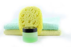 Container of gel, sponge and towels Royalty Free Stock Photography