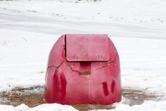 Container for grit and salt. Broken red container for grit and salt in winter time Royalty Free Stock Photo