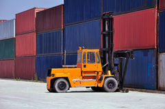 Container handling. Big forklift in a terminal royalty free stock photo