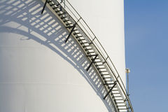 Container with ladder. Large industrial tank with ladder going up the side Stock Images