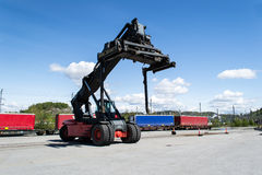 Container lift - truck. This is a large container truck at work in the dock in Halden, Norway Royalty Free Stock Image