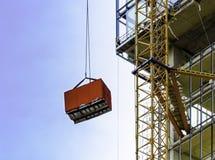 A container is lifted. A container is lifted in construction site Royalty Free Stock Photos