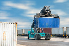 Container lifting truck in the storage yard., Business transportation. Royalty Free Stock Image