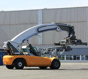 Container loader - reach stacker in the test area of Liebherr cr Stock Image