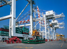 Container loading from port in Thailand. Moving cargo container on the ship Stock Photography