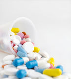 Container for medication with multicolored pills Royalty Free Stock Photo