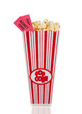Container of movie popcorn with tickets. A containter of movie poprcorn with two tickets on a white background Stock Image