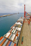 Container operation in port with cranes and gantry loading / discharging containers Stock Photo