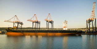 Container operation in port with cranes and gantry loading / discharging containers Stock Image