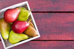 Container with pears over table with copy space Royalty Free Stock Image