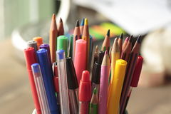 Container with pens and pencils stock photos
