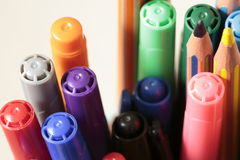 Container with pens and pencils royalty free stock photography