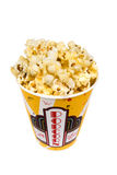 Container of popcorn. A piping hot container of movie popcorn shot with emphasis on the popcorn. Isolated on white for the designer's convenience stock photography