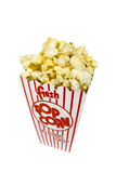 Container of Popcorn. A piping hot container of movie popcorn isolated on white royalty free stock photo