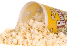 Container of popcorn with popcorn spilling out Royalty Free Stock Image