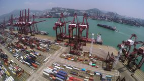 Container Port Aerial 4K Shot. 4K aerial shot of a container terminal. Wide pan left shot. With crane loading cargos to container vessel and trucks transporting stock video