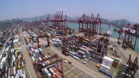Container Port. Beautiful 4K Aerial Shot. 4K aerial shot of a container terminal. Flying up and forward toward the terminal area. With crane loading cargos to stock video footage