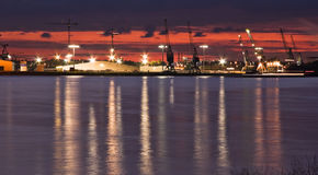 Container port with cranes at the riverside royalty free stock photography