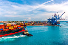 CONTAINER PORT OF FREEPORT GRAND BAHAMAS ISLAND. OCT., 8, 2014: Container ship delivers cargo to the port royalty free stock photography