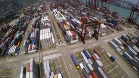 Container Port. 4K Aerial Shot. 4K aerial shot of a container terminal. Tilt up from containers to the whole terminal area. With crane loading cargos to stock video