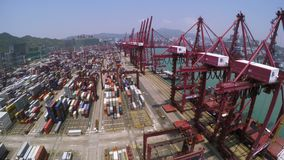 Container Port 4K Aerial Shot. 4K aerial shot of a container terminal. Wide pan right to the cranes. With crane loading cargos to container vessel and truck stock video