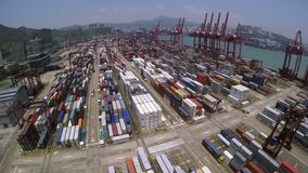 Container Port. Marvelous 4K Aerial Shot. 4K aerial forward shot of a container terminal. With crane loading cargos to container vessel and trucks transporting stock footage