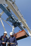 Container port, workers, cranes and trucks Royalty Free Stock Photos