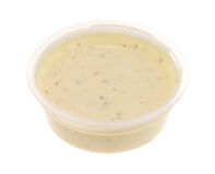 Container of ranch dressing on a white background Royalty Free Stock Photos