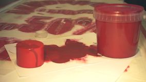 Container with red paint. Closeup stock video footage