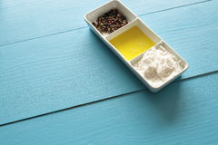 Container with salt, oil and pepper Royalty Free Stock Photo