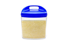 Container with semolina. Isolated on white background Royalty Free Stock Images