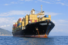 Container ship. Large container ship in mediterranean coast Royalty Free Stock Image