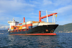 Container ship. Container cargo ship arriving in harbor Stock Photography