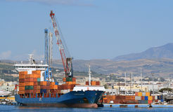 Container ship. Turkish cargo ship Alkin Kalkavan discharged containers at the port of Trapani in Sicily. Photo taken on 3th of June 2010 Stock Photo