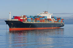 Container Ship. A container ship anchored in a harbour Stock Photos