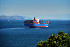 Container Ship. In Istanbul crosses the bosporus Stock Photo