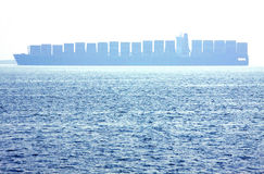 Container Ship. Sailing in Misty Harbor Royalty Free Stock Photos