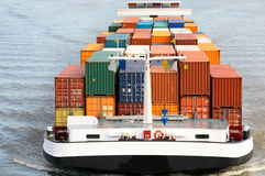 Container Ship. A large container cargo ship in a river stock image