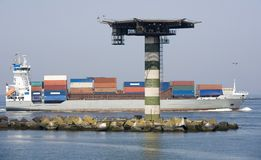 Container ship. Passing mushroom at the entrance of the port of rotterdam Royalty Free Stock Photos