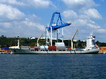Container Ship 2. Container Ship alongside loading containers at container terminal Stock Photo