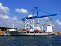 Container Ship 1. Container Ship alongside loading containers at container terminal Stock Images