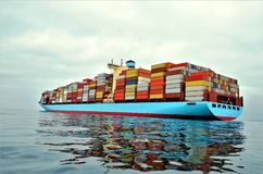 Container ship at anchor, waiting to enter port. stock image