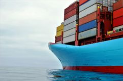 Container ship at anchor, waiting to enter port. royalty free stock image