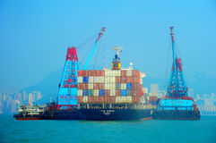 Container ship and barges Stock Photo