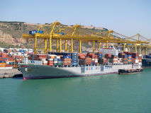 Container ship being loaded Stock Images