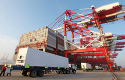 Container harbour. Container ship berthing Qingdao Port Royalty Free Stock Photos