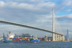 Container ship and bridge royalty free stock image