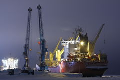 Container ship Captain Danilkin. On loading, sea port Dudinka, Russian Federation, December 2011 stock image